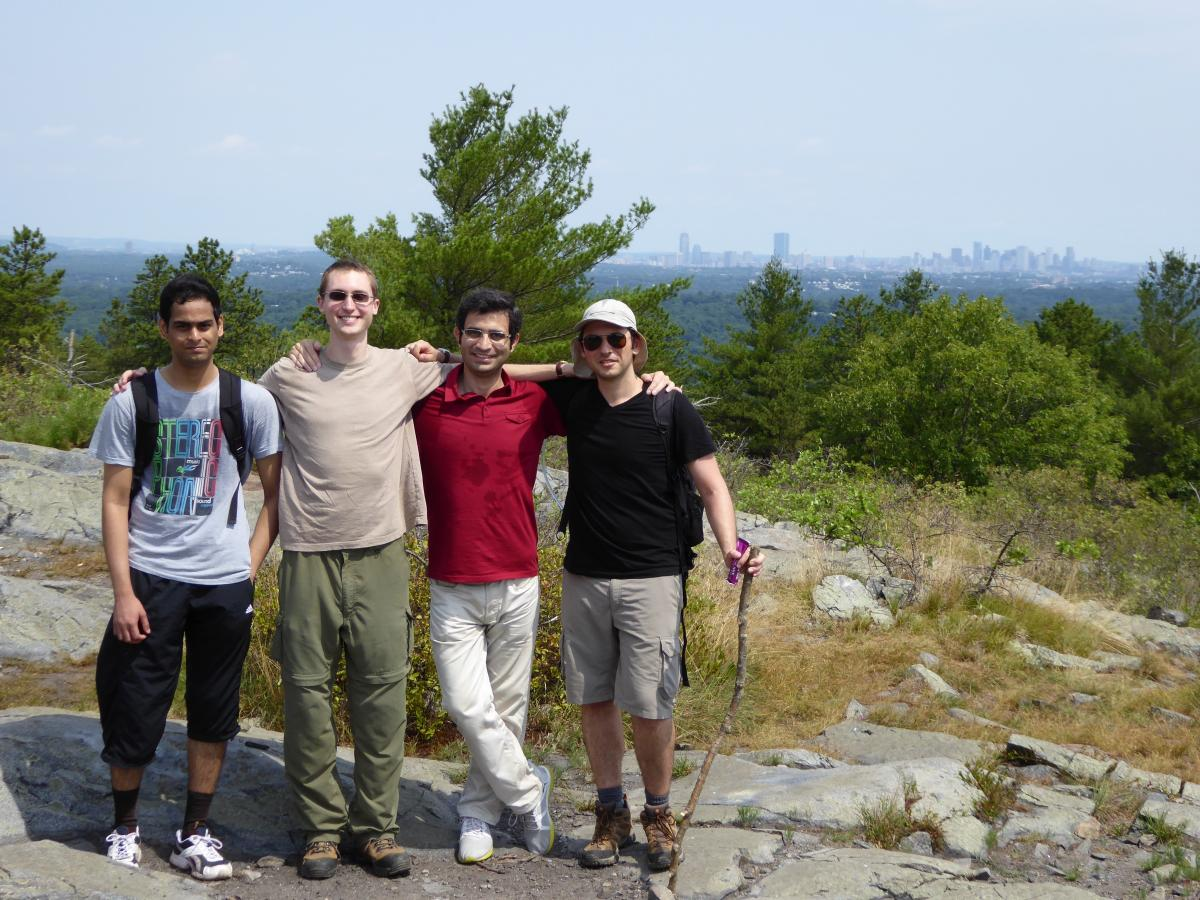 Group members hiking in the Blue Hills with Boston in the background.